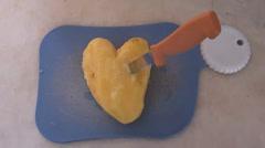 Knife in heart zoom in Stock Footage
