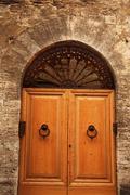 Ancient white oak door medieval stone town san gimignano tuscany italy Stock Photos