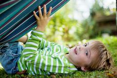 Cute little boy playing with hammock Stock Photos