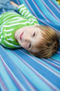 Cute little child lying in the hammock Stock Photos