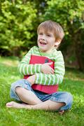adorable boy embracing a book - stock photo