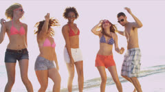 Group Teenage Vacation Friends Enjoying Dancing Beach Stock Footage