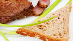 Meat food : roast red meat slices served on white plate Stock Footage