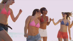 Young College Friends Enjoying Weekend Break Dancing Beach - stock footage