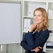 mid adult businesswoman smiling in office - stock photo