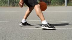 Basketball Player Dribbling the Ball Stock Footage