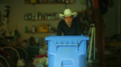 Putting recycleables recycle bin out Stock Footage
