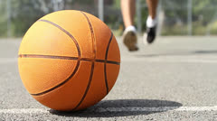 Basketball Player Picking up the Ball Stock Footage