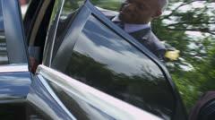 Stock Video Footage of International Banker Being Met Personal Chauffeur