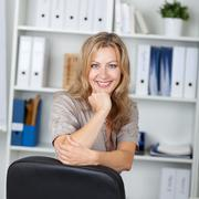 Confident businesswoman with hand on chin Stock Photos