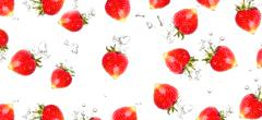 Stock Photo of juicy strawberries under water. healthy and tasty foods