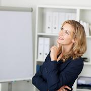 Stock Photo of mid adult businesswoman smiling in office