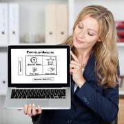 businesswoman showing bcg matrix chart on laptop screen - stock photo