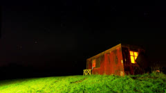 Night time-lapse with a shack and a starry sky Stock Footage