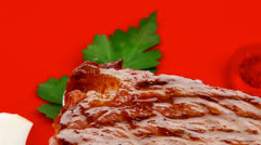 Barbecued meat : beef ( lamb ) garnished on red plate Stock Footage