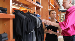 Customer speaking to sales manager in fashion store - stock footage