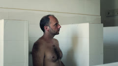 Inmate in showers of jail Stock Footage