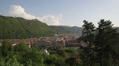 Beautiful panorama of medieval mountain town in green spring Stock Footage