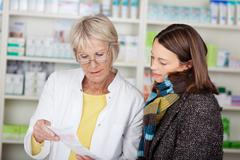 pharmacist explaining the prescription - stock photo