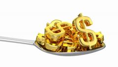 Spoon And Golden Dollars Stock Footage