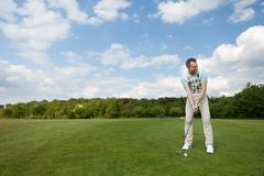 concentrated man playing golf - stock photo