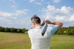practising golf - stock photo