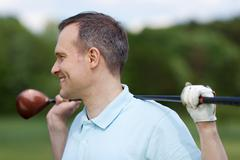 Relaxed golfer standing on green Stock Photos