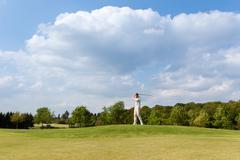 Man playing golf at course Stock Photos
