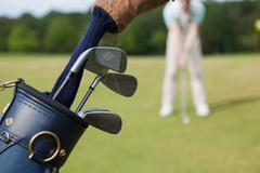 closeup of bag with golf clubs - stock photo