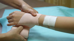 Stock Video Footage of first aid bandaging forearm