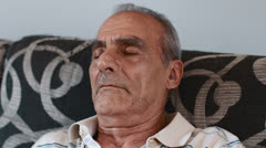 Old man is relaxing and sleeping on the sofa: home, sleep, relax, day time Stock Footage