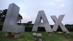 Plane Flying over LAX Sign - Airplane Overhead Flies over Highway with Audio - stock footage