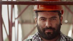 2of11 Young man at work in construction site, manual worker Stock Footage