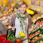 Smiling woman shopping for fresh produce Stock Photos