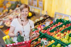 happy woman buying fresh produce - stock photo