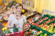 Stock Photo of happy woman buying fresh produce