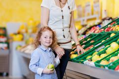 Stock Photo of mother and daughter in the supermarket