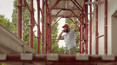 3of11 Young man at work in construction site, manual worker Stock Footage