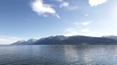 Grand Teton Mountains with lake in front Stock Footage