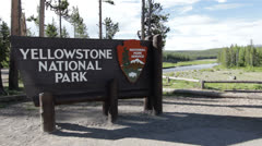 Sign entering Yellowstone national park Stock Footage