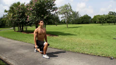 HD: man stretching outdoors - lunge. front view. Stock Footage