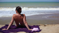 Beautiful woman on the beach 4 Stock Footage