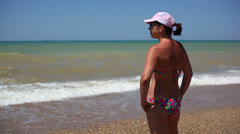 Pretty woman at the beach 7 Stock Footage