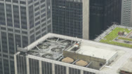 Stock Video Footage of City rooftop with air conditioners spinning