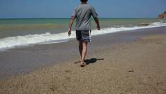 Man walking on the beach 1 Stock Footage