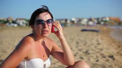 Woman speaks on the phone on sea 2 Stock Footage
