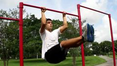 Leg lifts. outside environment. Gym training Stock Footage