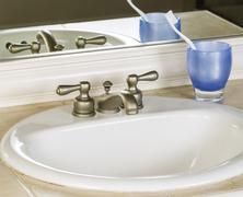 White bathroom sink and faucet Stock Photos