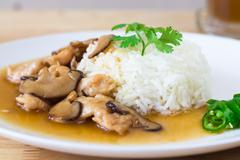 Chicken and mushroom with sauce over rice Stock Photos