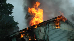 Amid the Forces of Nature - House Fire - Inferno Shoots Through the Roof Stock Footage